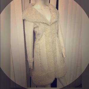 White faux fur BEBE coat. Stunning and very warm!